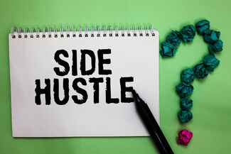 "A notebook with the word ""Side Hustle"" written in it."