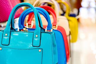 A colorful display of purses.