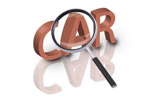 "A magnifying glass over the word ""car."""