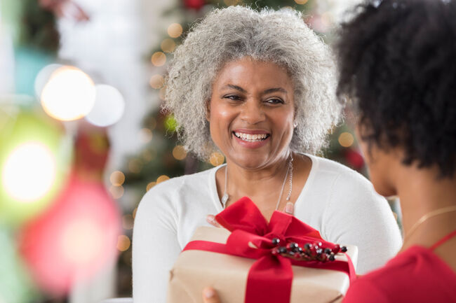 Two women exchanging gifts.