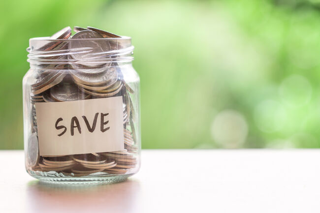 Jar labeled save with money in it