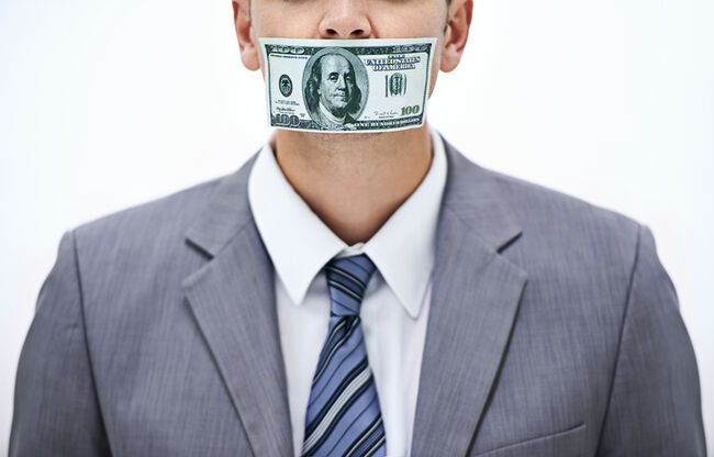A man with a dollar bill taped over his mouth.