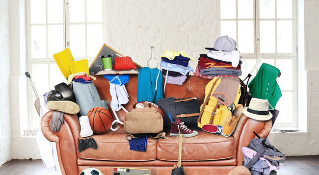 A couch cluttered with possessions.