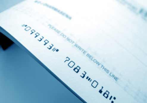 A close up of the routing number at the bottom of a check.