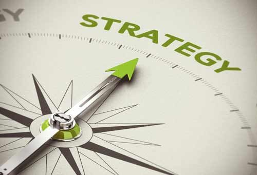 "A compass pointing to the word ""Strategy."""